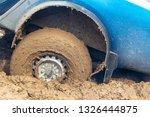 car wheel slips in the dirt in... | Shutterstock . vector #1326444875