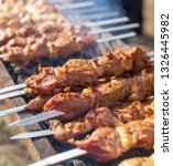 shish kebab on skewers is fried ... | Shutterstock . vector #1326445982