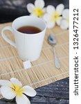 cup of dark tea on bamboo... | Shutterstock . vector #1326477212