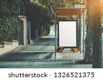 an urban bus stop with blank... | Shutterstock . vector #1326521375