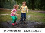 cute kids jumping into water... | Shutterstock . vector #1326722618