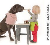 Stock photo young girl playing kitchenette with the dog great dane 132672662