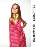 beautiful little girl eating... | Shutterstock . vector #132674432