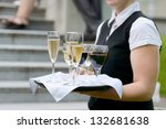 waitress with dish of champagne ... | Shutterstock . vector #132681638