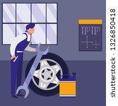 mechanic worker with tire car... | Shutterstock .eps vector #1326850418