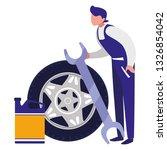 mechanic worker with tire car... | Shutterstock .eps vector #1326854042
