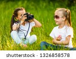 two little girls sitting on... | Shutterstock . vector #1326858578