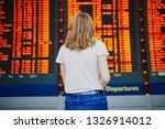 young woman in international...   Shutterstock . vector #1326914012