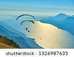 Paraglider Flying Over The...