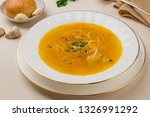 chicken soup bouillon in a plate | Shutterstock . vector #1326991292