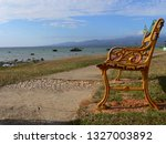 solitary rusty bench on a... | Shutterstock . vector #1327003892