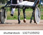 legs of a trotter horse and... | Shutterstock . vector #1327135052