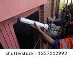 rope access abseiler handy man... | Shutterstock . vector #1327212992