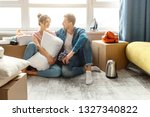 young family couple bought or... | Shutterstock . vector #1327340822