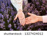 wedding rings on hands in the... | Shutterstock . vector #1327424012