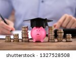 stacked coins and piggy bank... | Shutterstock . vector #1327528508
