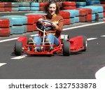 go kart racer on the track.... | Shutterstock . vector #1327533878