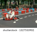 go kart racer on the track.... | Shutterstock . vector #1327533902