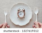 hands holding fork and spoon... | Shutterstock . vector #1327619312