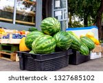 watermelons in a plastic box. | Shutterstock . vector #1327685102
