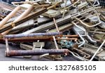 old radiators and water pipes ... | Shutterstock . vector #1327685105