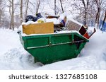 the metal container is filled... | Shutterstock . vector #1327685108