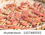dried pork on threshing... | Shutterstock . vector #1327685552