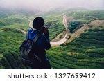 backpacker traveling into tea...   Shutterstock . vector #1327699412