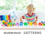 kid playing with colorful toy... | Shutterstock . vector #1327733342