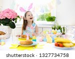 family easter breakfast. child... | Shutterstock . vector #1327734758