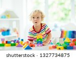 kid playing with colorful toy... | Shutterstock . vector #1327734875