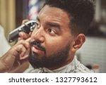 portrait of unshaven black man... | Shutterstock . vector #1327793612