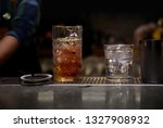 glass and jug of tasty cocktail ... | Shutterstock . vector #1327908932
