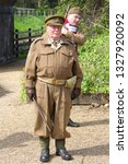 Small photo of WEYBOURNE, NORFOLK, UK - MAY 26, 2013: The indomitable Captain Mainwaring, played by a reenactor, creates a vintage scene at the NNR, as the officer of the Walmington-on-Sea Home Guard Platoon.