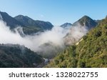 cloudy mountains china | Shutterstock . vector #1328022755
