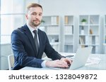 serious young businessman in... | Shutterstock . vector #1328049872