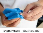jeweller hand polishing and...   Shutterstock . vector #1328107502