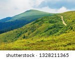 country road uphill to distant... | Shutterstock . vector #1328211365