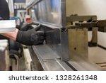 operator bending metal sheet by ... | Shutterstock . vector #1328261348