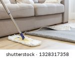Cleaning Floor With Mop Under...