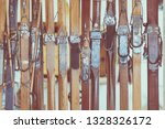 old wooden skis as a background.... | Shutterstock . vector #1328326172