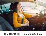 pregnant woman driving with... | Shutterstock . vector #1328337632