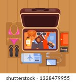 tourist open case suitcase full ...   Shutterstock .eps vector #1328479955