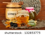 jars of honey  wooden barrel ... | Shutterstock . vector #132853775