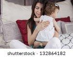 happy hispanic mother hugging... | Shutterstock . vector #132864182