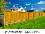 long wooden cedar fence. | Shutterstock . vector #132865448