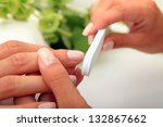 woman in a nail salon receiving ... | Shutterstock . vector #132867662