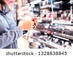 woman buying make up at... | Shutterstock . vector #1328838845