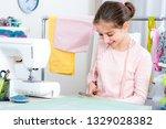 smiling little girl seamstress... | Shutterstock . vector #1329028382