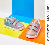 pair of baby shoes on colour... | Shutterstock . vector #1329044858